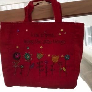 A little girls bedazzled Cordero Bag/Pocket Book.
